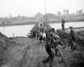 Belgian civilians cross a pontoon bridge over the Albert Canal, 1944