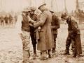 Treating a wounded German prisoner near Langemarck, 26 September 1917