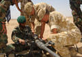 Members of 3rd Battalion, The Parachute Regiment, training Afghans in the use of the Browning .50 Calibre machine gun, 2006