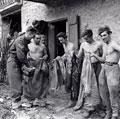 German prisoners of war being deloused before interrogation, Castel del Rio, Italy, October 1944