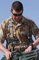 A member of The Parachute Regiment's Pathfinder Platoon prepares his weapon on a firing range at Gereshk, Helmand Province, Afghanistan, 2006
