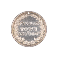 Silver medal depicting the defence of Chew's storehouse at the Battle of Germantown, 1777