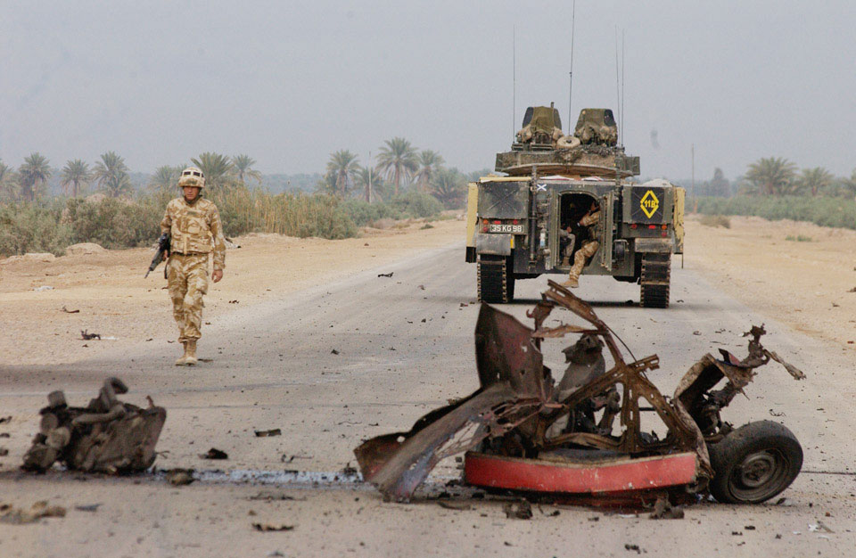 Commanding Officer, Black Watch, walks from his Warrior to the scene of a vehicle bomb, Iraq, October 2004