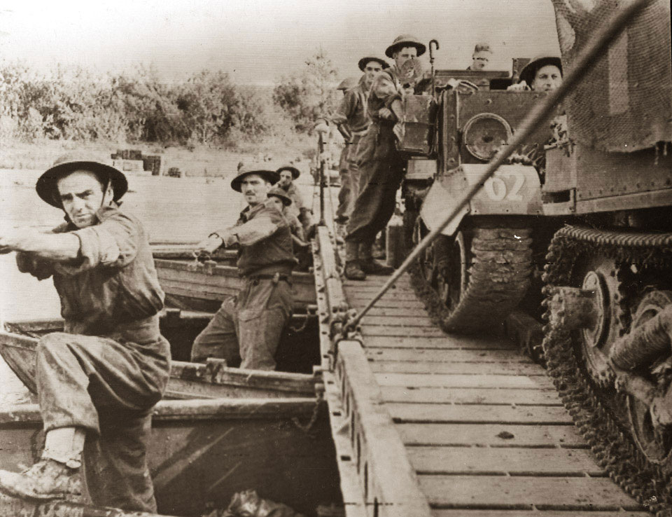 Engineers moving across the River Volturno near Castello Volturno, October 1943