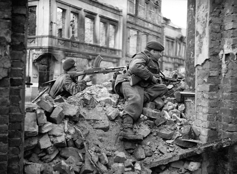 Two commandos looking out for snipers among the ruins of Osnabruck, Germany, 4 April 1945
