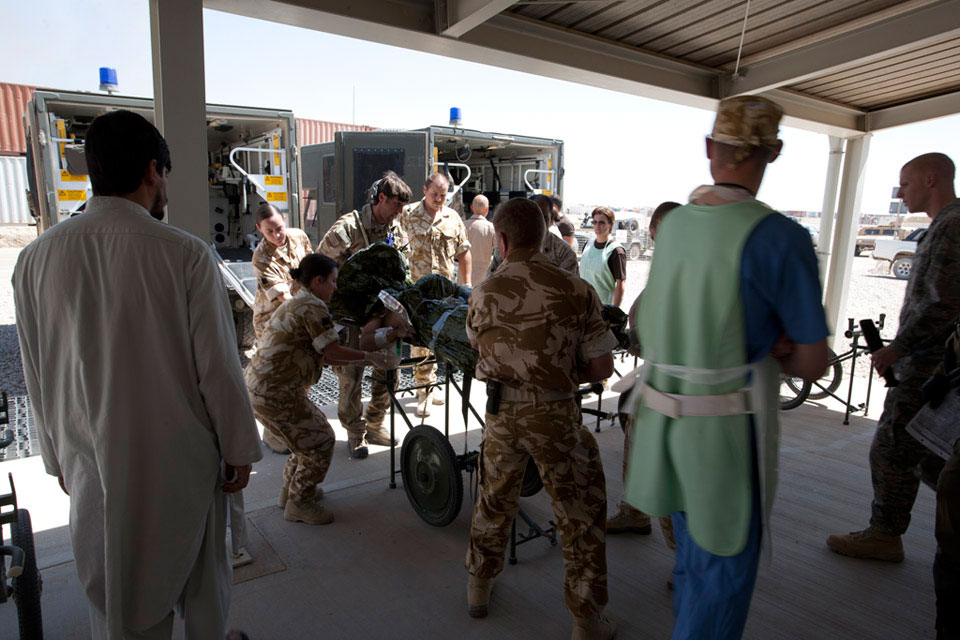 An improvised explosive device (IED) casualty arrives for treatment at Camp Bastion Hospital, 2009