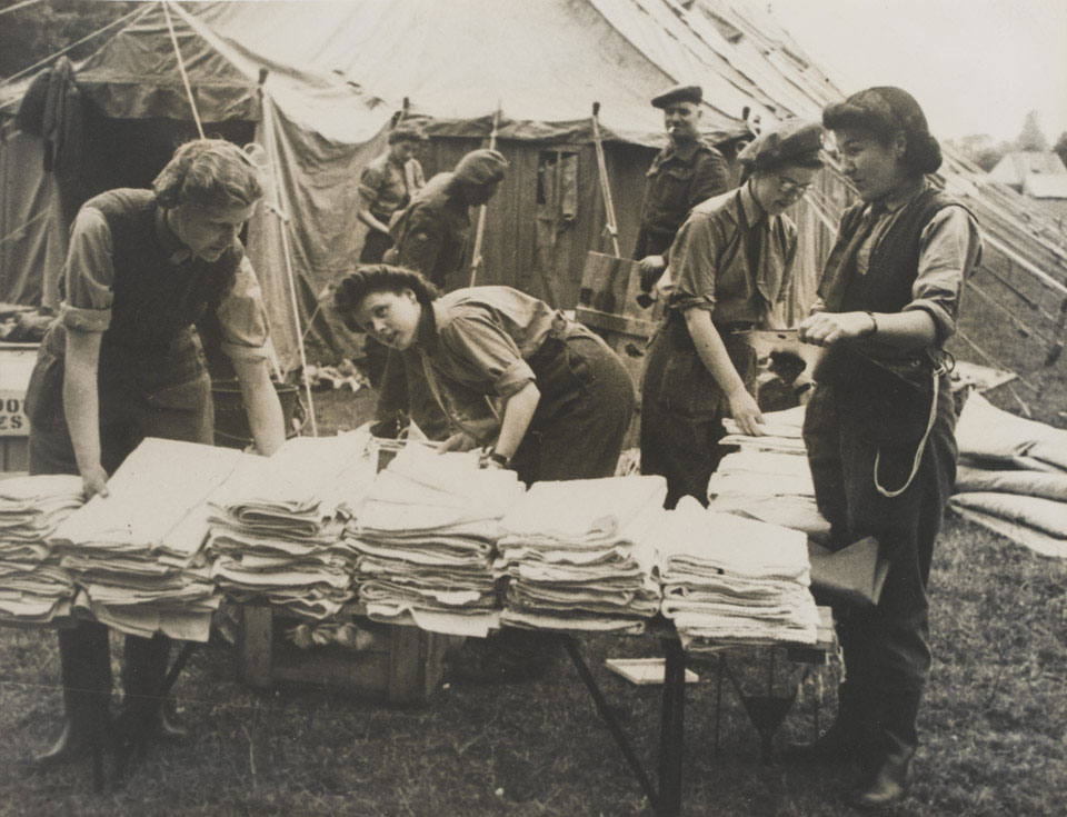 Queen Alexandra's Imperial Military Nursing Service (QAINS) unpacking stores, Normandy, July 1944