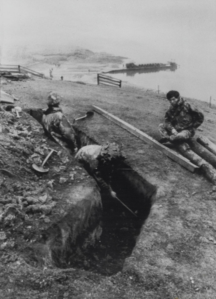 1st Battalion,7th Gurkha Rifles, digging a defensive position on the shore of San Carlos Bay, Falkland Islands, 1982