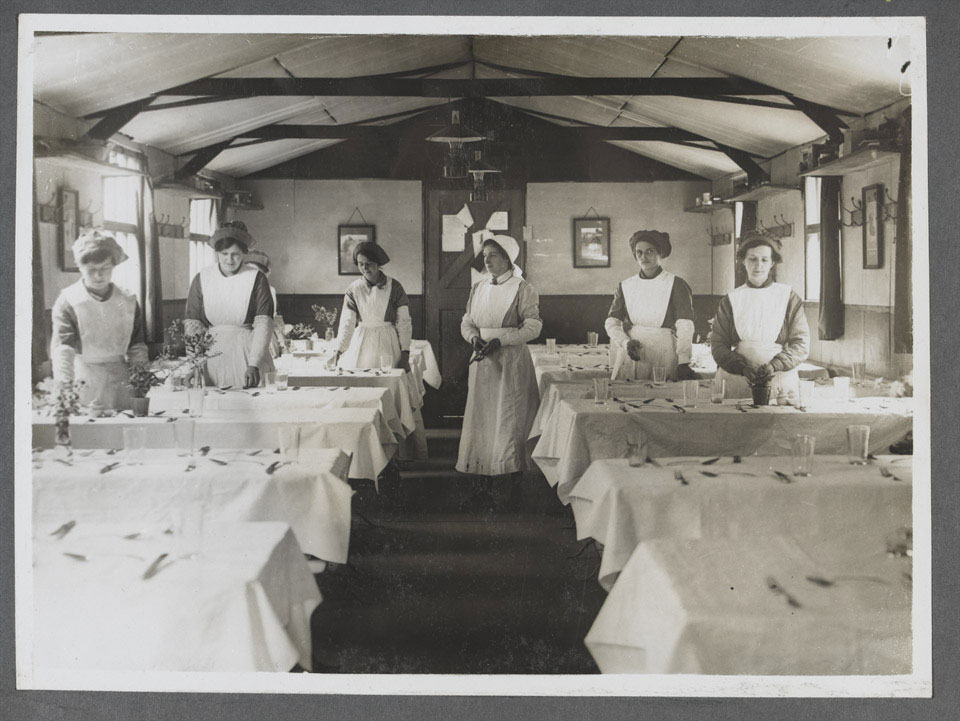 Women's Army Auxiliary Corps waitresses setting tables, 1917 (c)