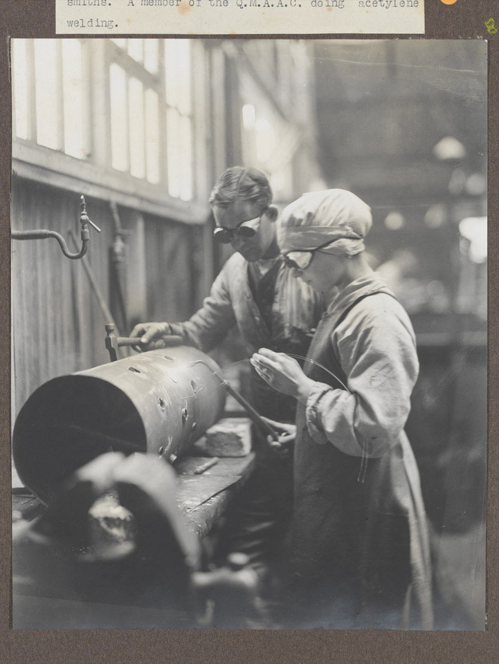Women's Army Auxiliary Corps mechanic in a workshop, 1917 (c)