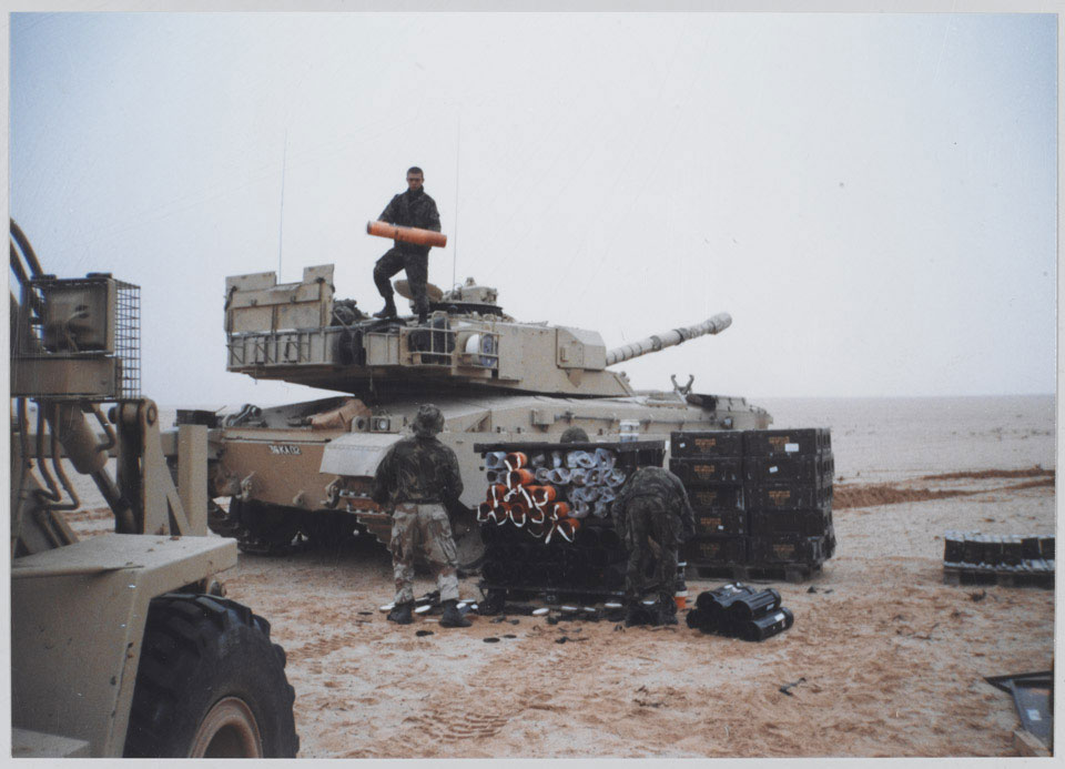 Re-arming a Challenger tank in the desert, 1991