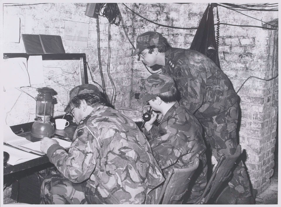 Soldiers from 1st Battalion The Royal Irish Rangers in a temporary command post, Germany, February 1980