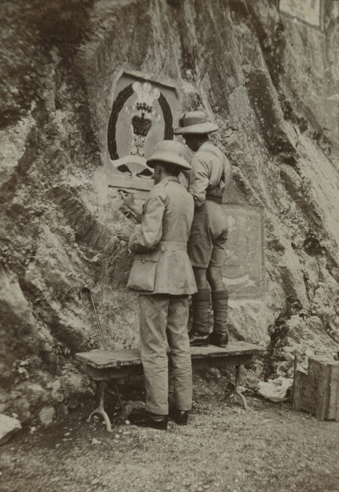 Regimental Sergeant Major Leonard Drinkwater painting the Middlesex badge in the Khyber Pass, 1925 (c)