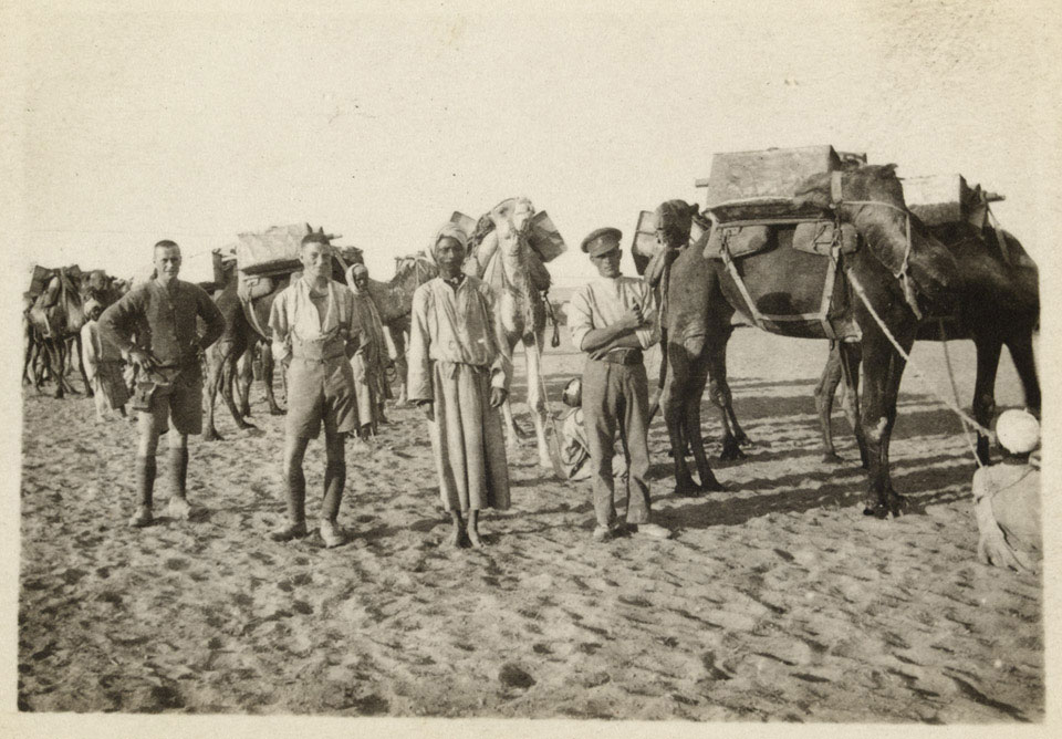 British soldiers with members of the Egyptian Camel Transport Corps, carrying water for troops, Sheik Nakhrur, 1917