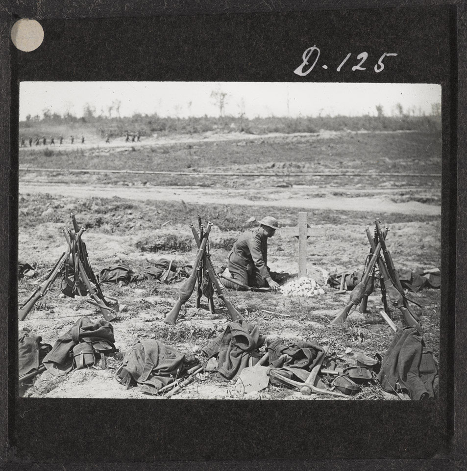 Tending a grave near Mametz Wood, August 1916