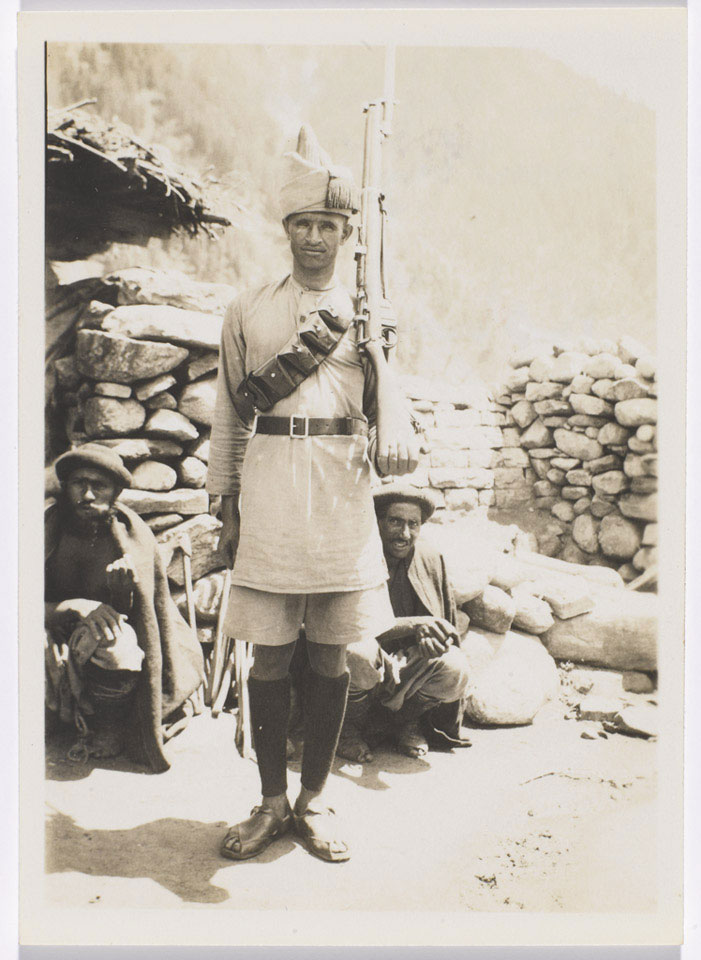 An Afridi sentry of the Frontier Constabulary with Kohistani prisoners, 1934