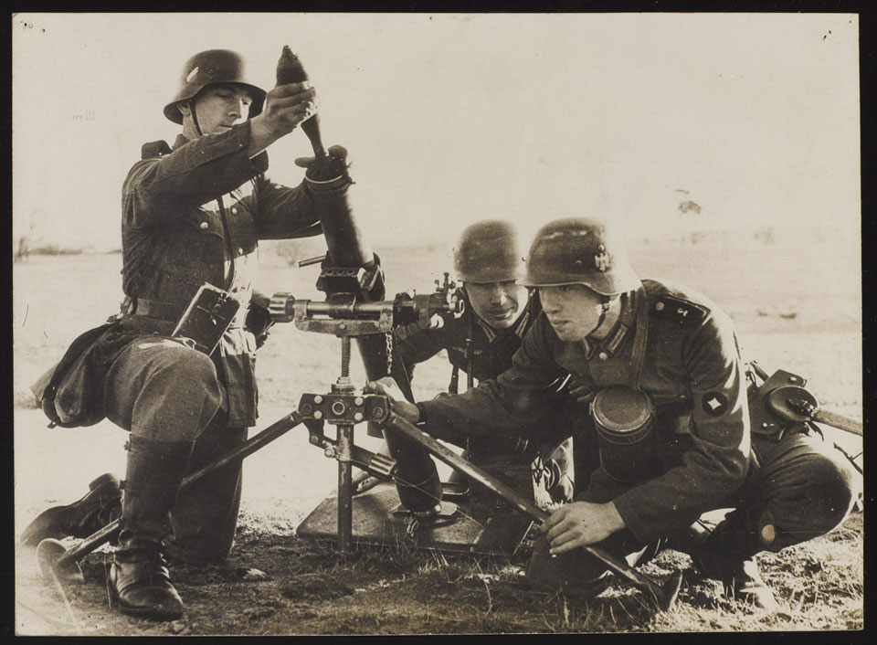 German infantrymen being taught how to use a mortar at the Doberitz school, near Berlin, 28 August 1938