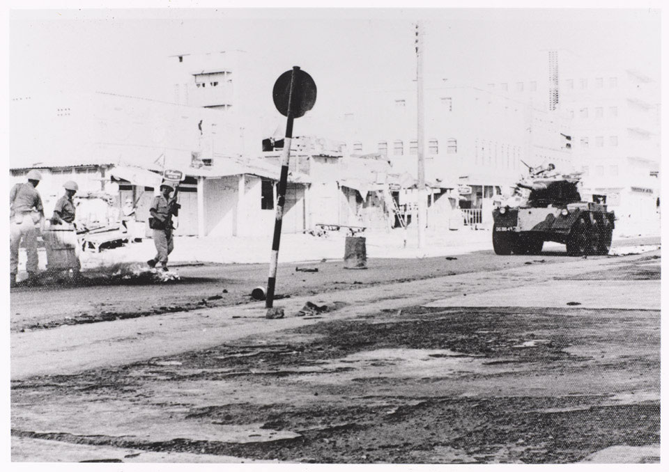A Saladin armoured car patrols the Aden streets during a riot, 1967