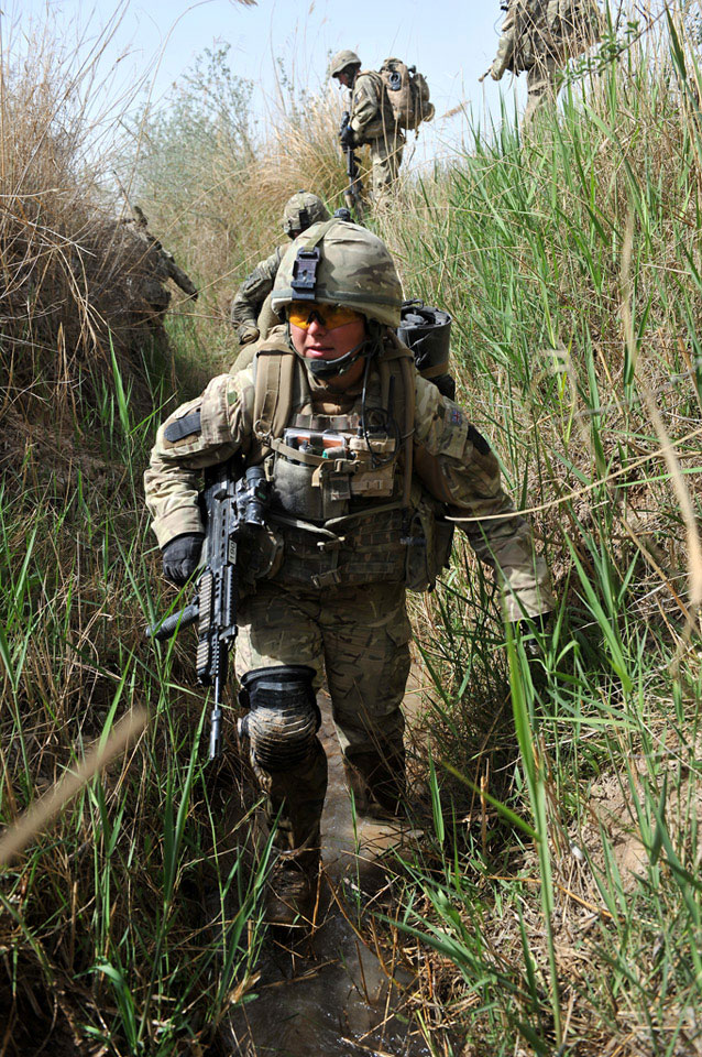 A combat medic from 16 Close Support Medical Regiment, on patrol in Helmand Province, Afghanistan, 2011