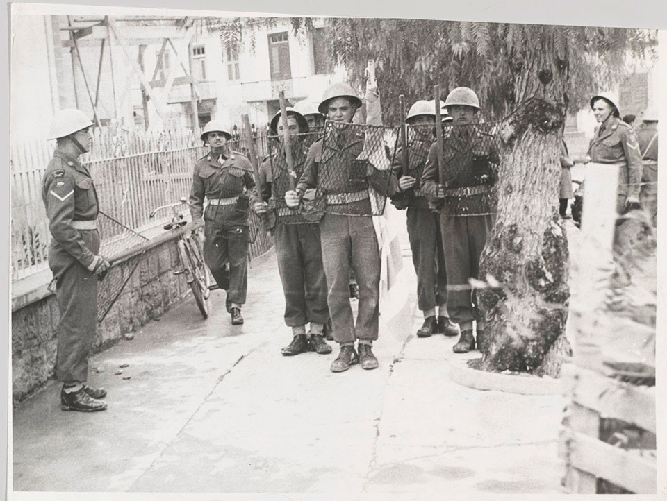 Troops of the South Staffordshire Regiment with batons and riot shields at the time of student rioting in Nicosia, 29 January 1956