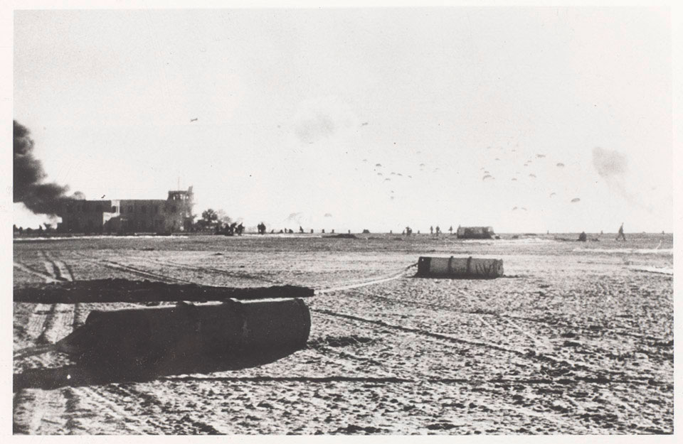 Equipment canisters litter El Gamil airfield as paratroopers land on the drop zone, 5 November 1956