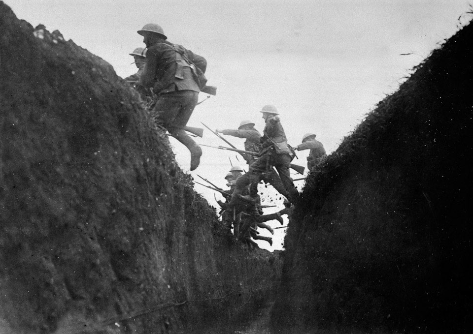 Troops in training jumping over trench, 1916 (c)