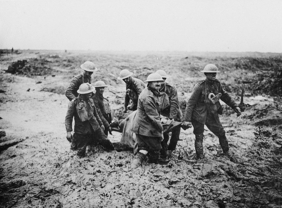 Soldiers evacuating a wounded man on a stretcher, 1917 (c)