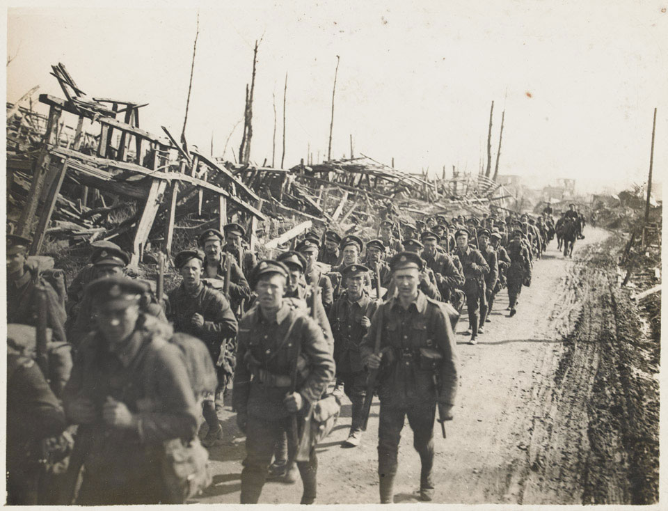 Soldiers of the Duke of Cambridge's Own (Middlesex Regiment) moving up through Achiet-le-Petit, March 1918