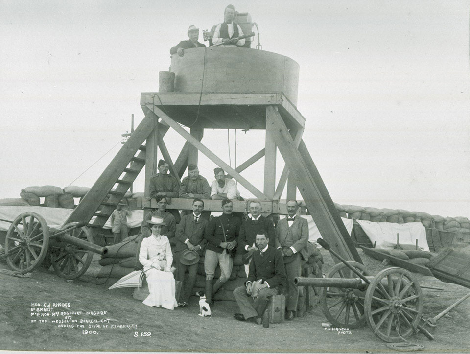 Cecil Rhodes and members of the Kimberely garrison at the Wesselton searchlight, Boer War, 1900