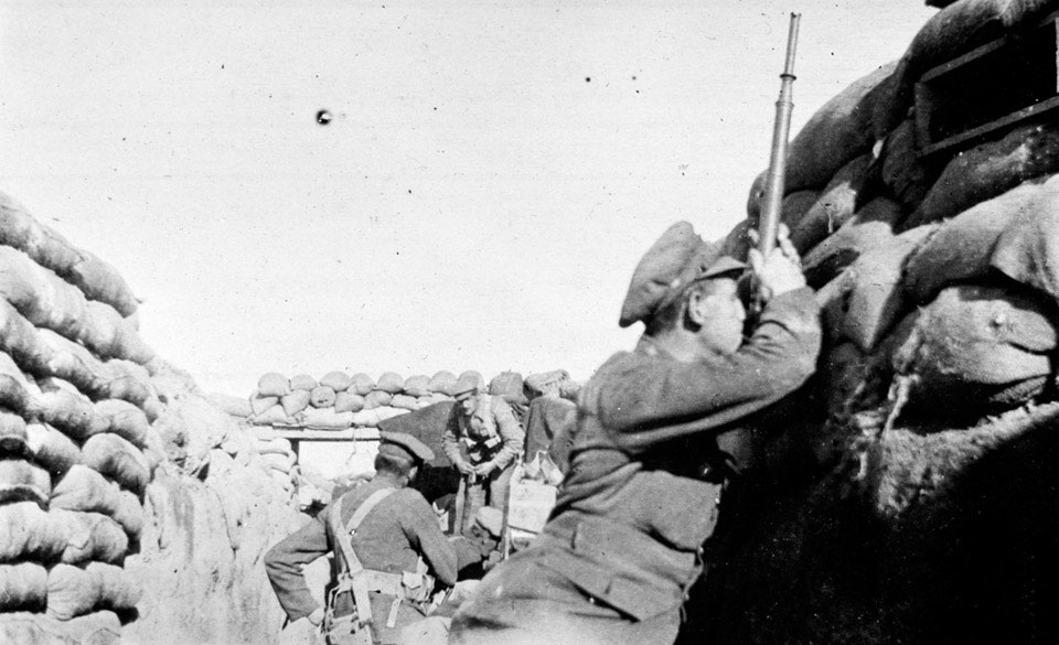 A soldier from 2/2nd Battalion The Royal Fusiliers using a trench periscope, 1915