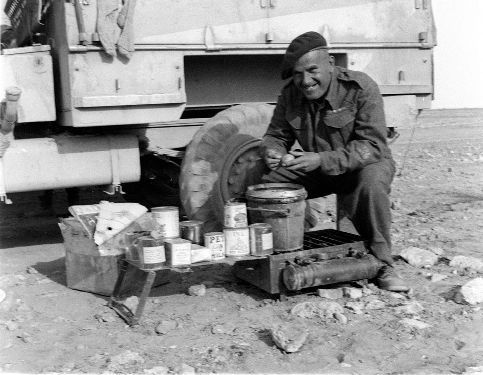 Sub-Conductor Mayland preparing rations in the desert, 1942 (c)